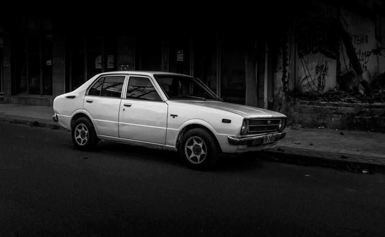 An old car on a city street