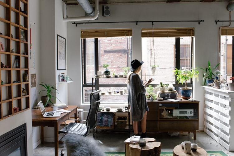 A woman standing in an apartment living room